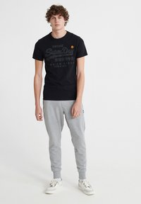 Superdry - COLLECTIVE - Tracksuit bottoms - grey marl - 1