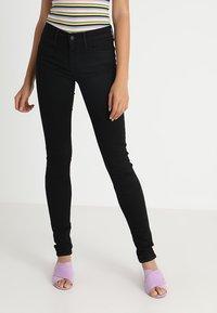 Levi's® - 710 SUPER SKINNY - Jeans Skinny - black galaxy - 0