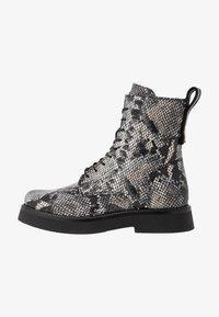 MJUS - Kotníkové boty na platformě - nero - 1