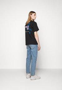 GCDS - TOM & JERRY TEE - Print T-shirt - black - 2