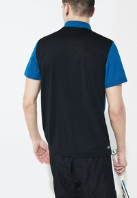 Lacoste Sport - TENNIS TAPERED - Polo shirt - blue/black - 1