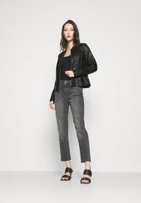 Vero Moda - VMBUTTERALBA COATED JACKET - Faux leather jacket - black - 1