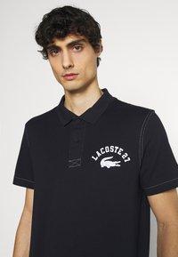 Lacoste - Polo shirt - abimes - 3