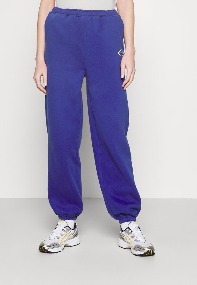LOGO COLLAGE PANTS - Joggebukse - blue