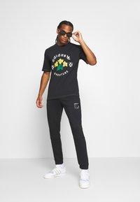 adidas Originals - ICON  - Tracksuit bottoms - black - 1