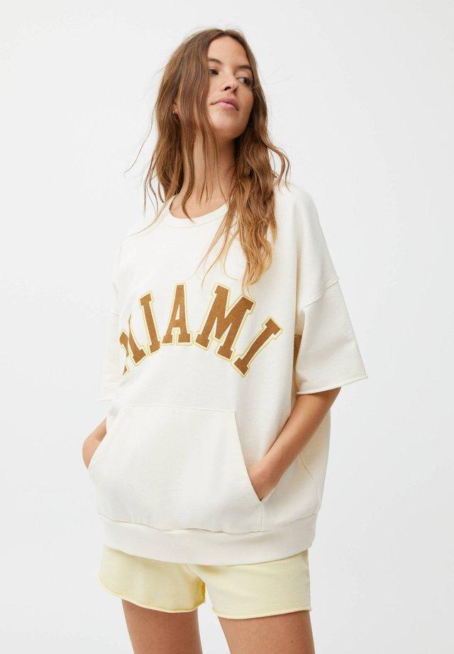 T-Shirt print - mottled beige