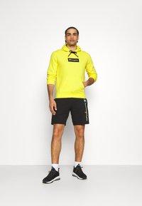Champion - HOODED - Sweatshirt - yellow - 1