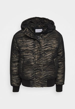 ZEBRA PUFFER - Light jacket - irish cream/black