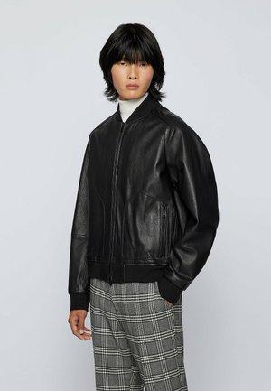 NORAN - Leather jacket - black