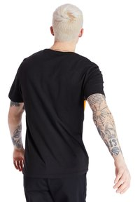 Timberland - CUT AND SEW TEE - Print T-shirt - black - 2