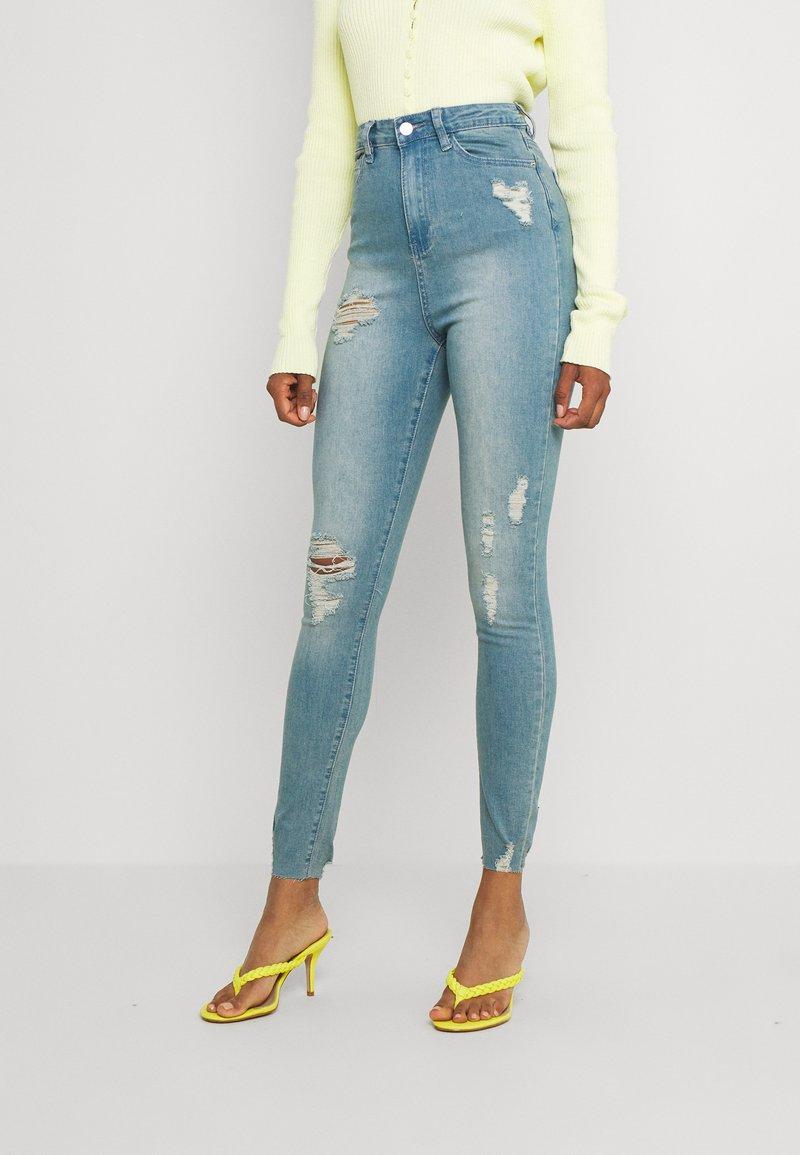 Missguided - SINNER HIGHWAISTED DESTROYED - Jeans Skinny Fit - light blue