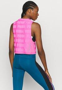 Puma - TRAIN FIRST MILE XTREME TANK - Sports shirt - luminous pink - 2