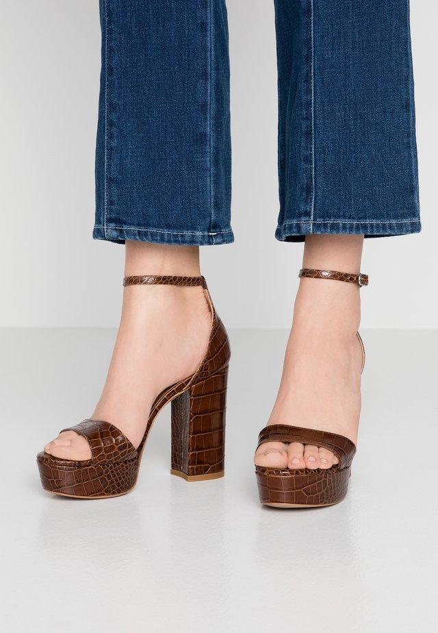 High heeled sandals - cocco choc