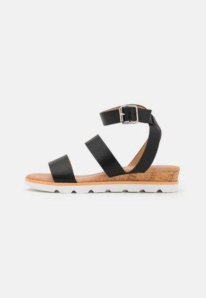 WICINIA - Wedge sandals - black