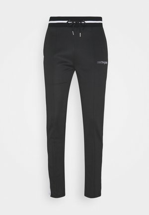 TRACK PANTS - Tracksuit bottoms - black