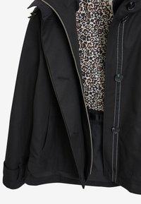 Next - Waterproof jacket - black - 1