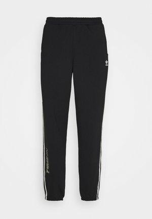 NINJA PANT UNISEX - Pantalon de survêtement - black
