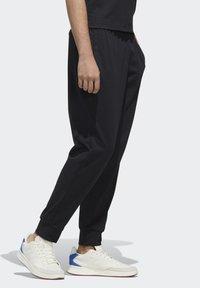 adidas Performance - ESSENTIALS JOGGER JOGGERS - Pantaloni sportivi - black - 2