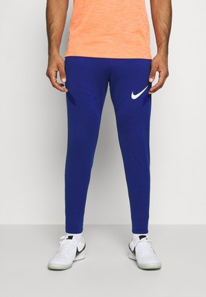 DRY STRIKE PANT - Tracksuit bottoms - deep royal blue/dark beetroot/white