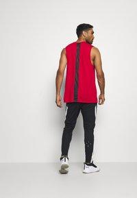 Jordan - AIR DRY PANT - Pantalones deportivos - black/white - 2