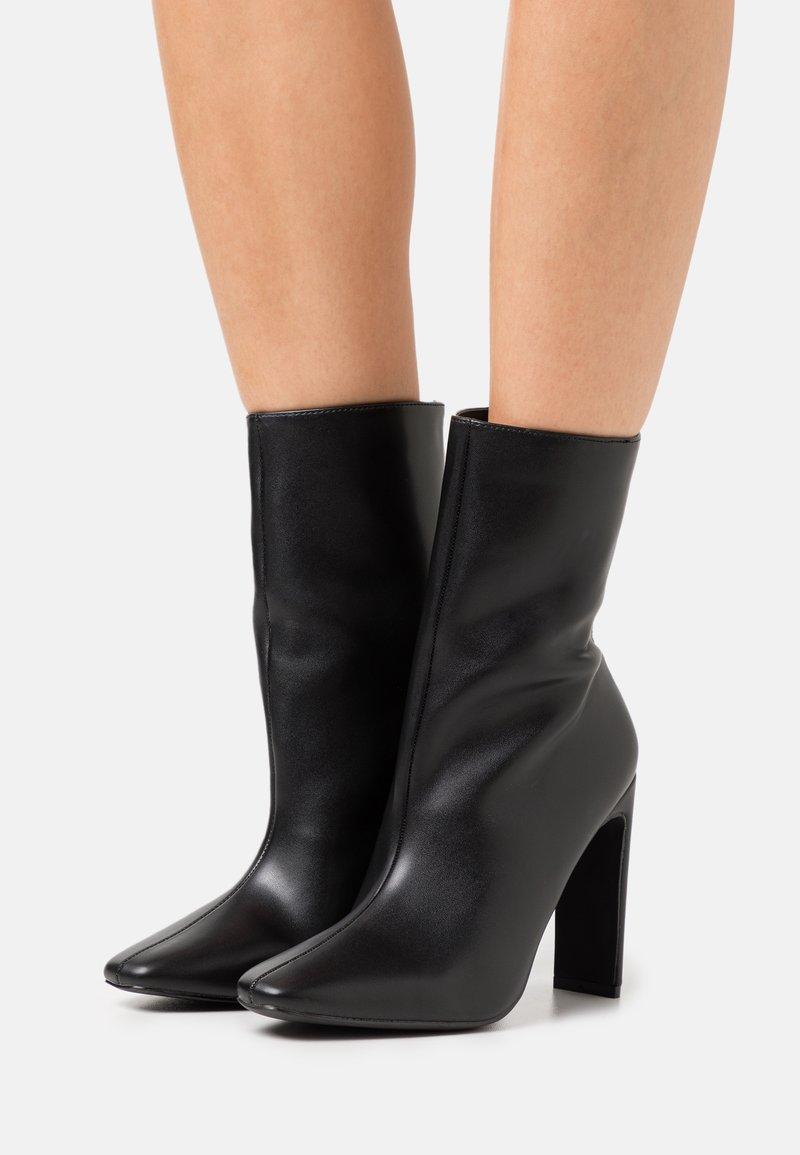 RAID - ALEENA - Kotníková obuv na vysokém podpatku - black