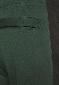 Nike Sportswear - Tracksuit bottoms - galactic jade/sequoia/galactic jade/sequoia - 3