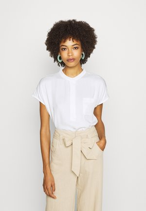 KATOKWE - Button-down blouse - milk