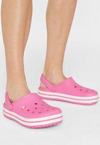 Crocs - CROCBAND RELAXED FIT - Sandalias planas - pink lemonade / white - 1