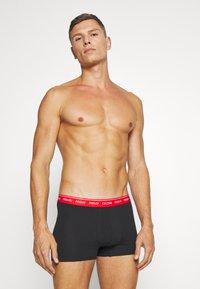 Calvin Klein Underwear - DAYS OF THE WEEK TRUNK 7 PACK - Onderbroeken - black - 7