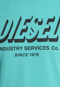 Diesel - DIEGOS UNISEX - Print T-shirt - turquoise - 2