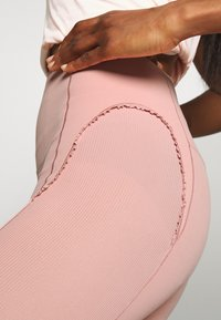 Nike Performance - YOGA - Leggings - rust pink/beige - 4