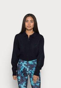 Topshop Petite - TIE DYE FLARE - Trousers - blue - 0