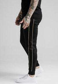 SIKSILK - ASTRO CUFFED TRACK PANTS - Tracksuit bottoms - black/gold - 4