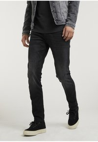 CROWN RIX - Jeans Tapered Fit - black