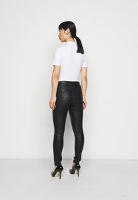 Dorothy Perkins Petite - ANIMAL FRANKIE - Jeans Skinny Fit - black - 2