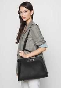 Guess - UPTOWN CHIC - Handbag - black - 1