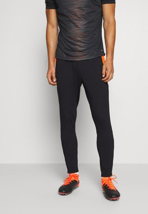 PANT - Träningsbyxor - black/shocking orange