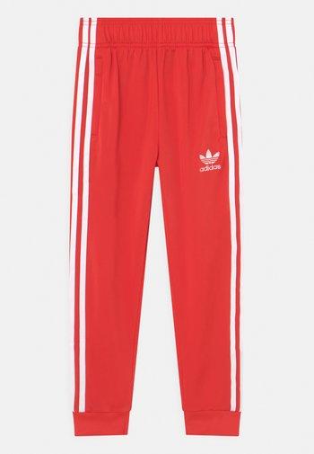 UNISEX - Teplákové kalhoty - red/white