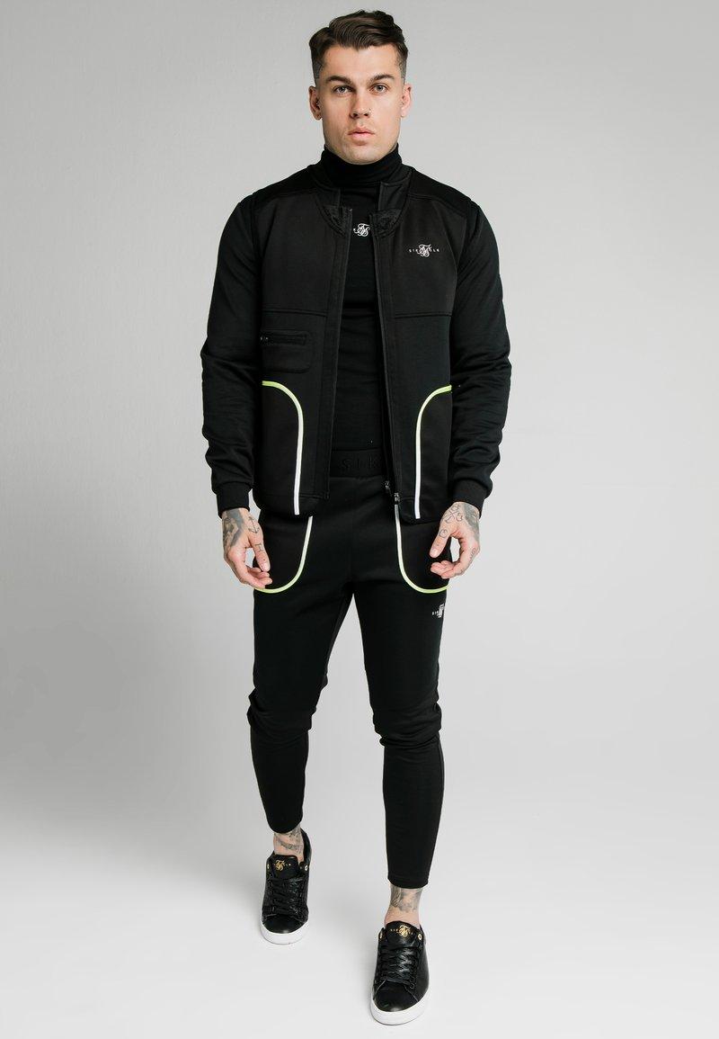 SIKSILK - Waistcoat - black & fluro white