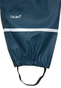 CeLaVi - RAINWEAR SUIT BASIC SET WITH FLEECE LINING - Rain trousers - iceblue - 4