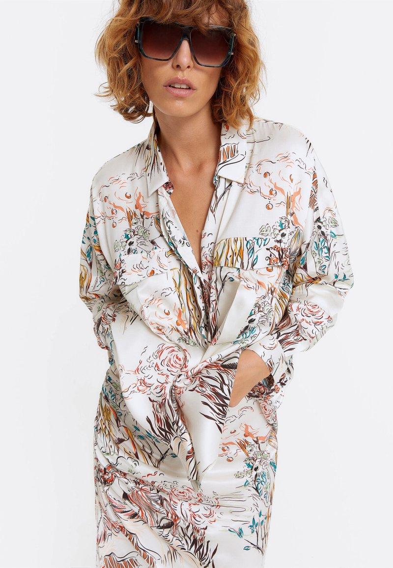 Uterqüe - Button-down blouse - beige