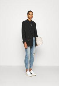 Calvin Klein Jeans - CUT OUT BACK  - Sweatshirt - black - 1