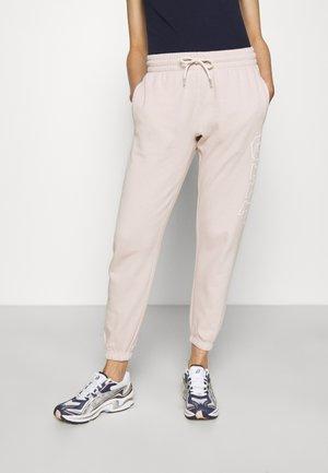 EASY - Spodnie treningowe - dull rose