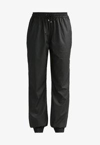 UNISEX TROUSERS - Teplákové kalhoty - black