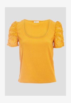 T-shirt imprimé - jaune foncé