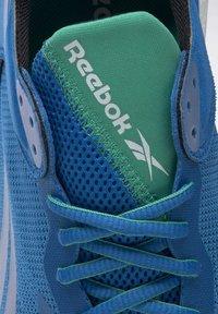 Reebok - FLOATRIDE ENERGY SYMMETROS SHOES - Stabilty running shoes - blue - 8