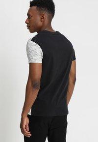 YOURTURN - Print T-shirt - black/off-white - 2