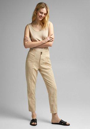 RUFFLE - Trousers - beige