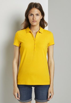 MIT HENLEY-AUSSCHNITT - Polo shirt - deep golden yellow