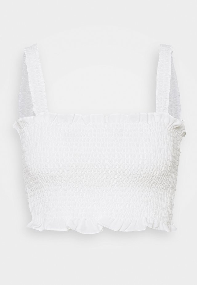 CARE SLEEVELESS SMOCKED CROP WITH RUFFLE TRIM - Toppi - white